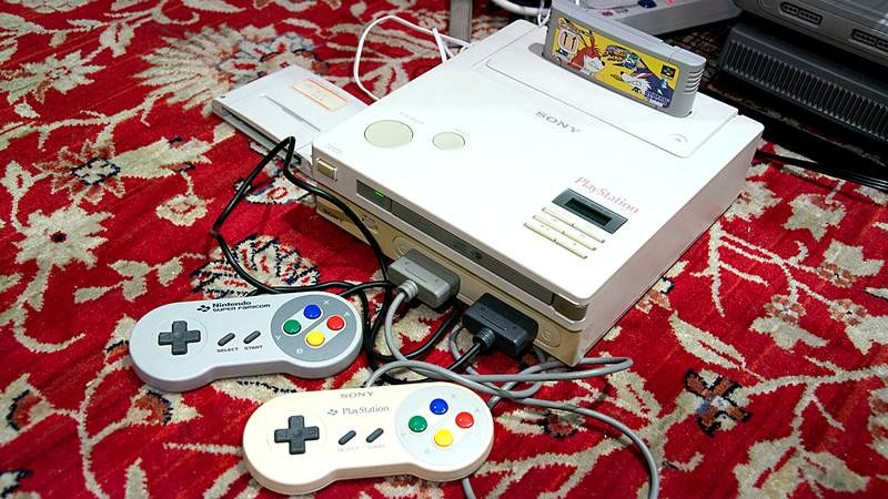Máy chơi game bốn nút kết hợp PS1 xuất hiện sau 26 năm
