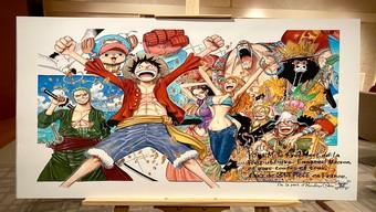 Không quản ngại đường xa, Tổng thống Pháp vẫn sang Nhật nhận tranh ... One Piece có chữ ký tác giả